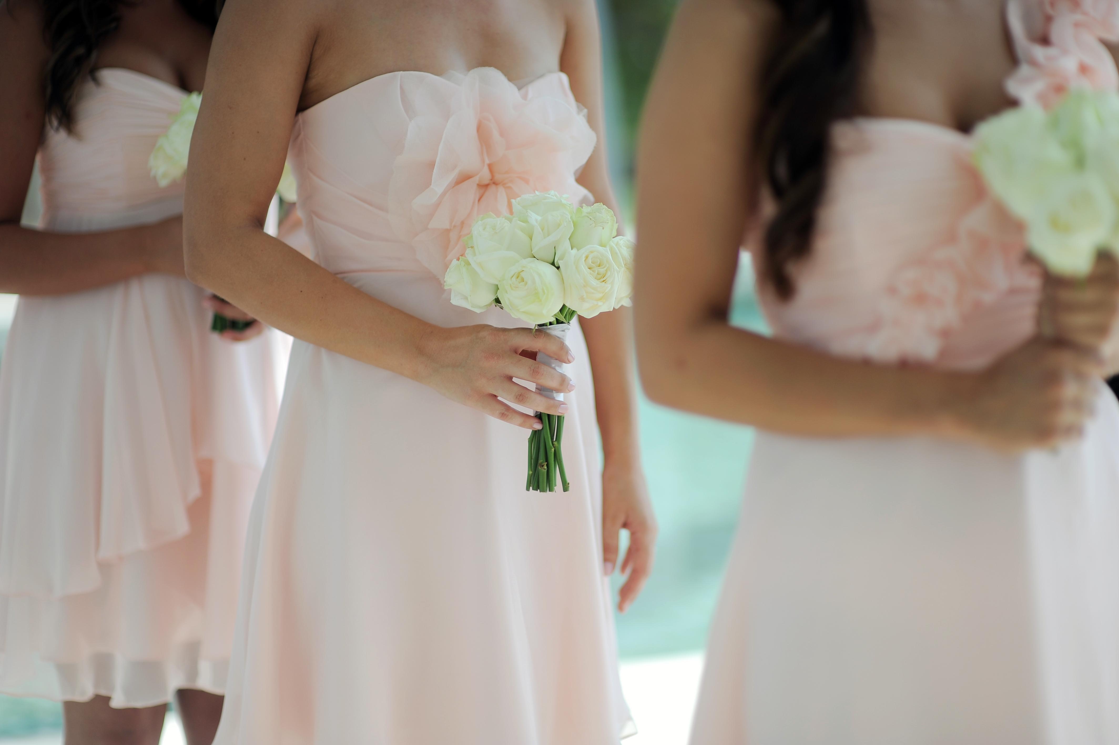 Pure White  Rose Bridesmaid Bouquet Cliff top Wedding Bali by Destination Wedding Planners Jody Q Weddings Bali Wedding Planners Jody Q Weddings  www.jodyqweddings.com.au